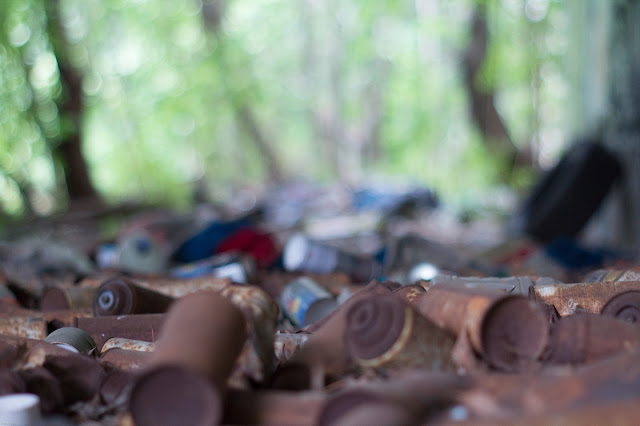 Pile of Old Graffiti Cans with Bokeh
