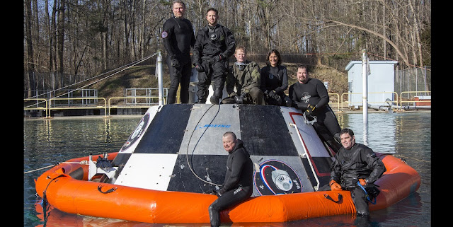 Members of the Air Force's 45th Operations Group Detachment 3 , Patrick AFB, Fla., and the 88th Test and Evaluation Squadron, Nellis AFB, Nev., pose with NASA Astronaut Suni Williams after testing and evaluating support equipment at the Hydro Impact Basin at NASA's Langley Research Center in after completing a practice session with a mock-up of a Boeing CST-100 Starliner. Det. 3, from Patrick AFB, Fla., coordinates Department of Defense contingency support for America's human space flight programs. Detachment 3 was chartered in 1959 by the Secretary of Defense as the DoD Mercury Support Office [later renamed DoD Manned Space Flight Support Office (DDMS)], its express purpose is providing DoD support to our nation's human space flight programs, putting people into space and returning them safely to Earth. (Courtesy photo/NASA)