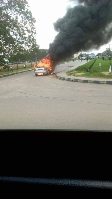 Photos: Young man drives car to Akwa Ibom House of Assembly complex, sets it on fire and fled