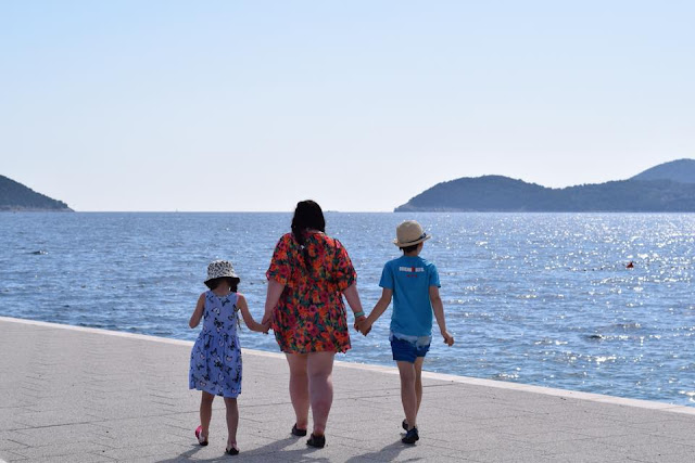 Family walking by the Sea in Croatia
