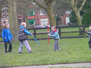 boys fighting with plastic light sabres