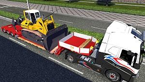 DOLL VARIO trailer with Liebherr PR 764 bulldozer