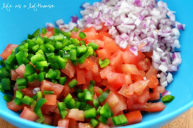 This homemade Pico de Gallo is full of diced tomatoes, jalapeños and onion with a few squeezes of fresh lime juice and a sprinkle of kosher salt. Life-in-the-Lofthouse.com