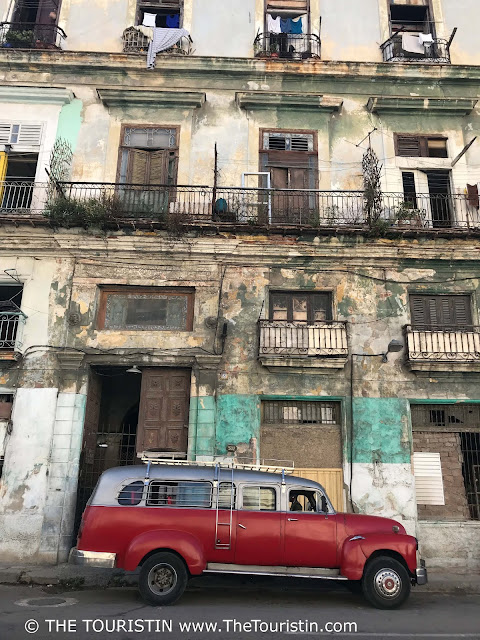 classic car facades behind the Capitolio national vieja havana cuba the touristin