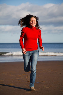 Thin Woman Running on Beach Sand