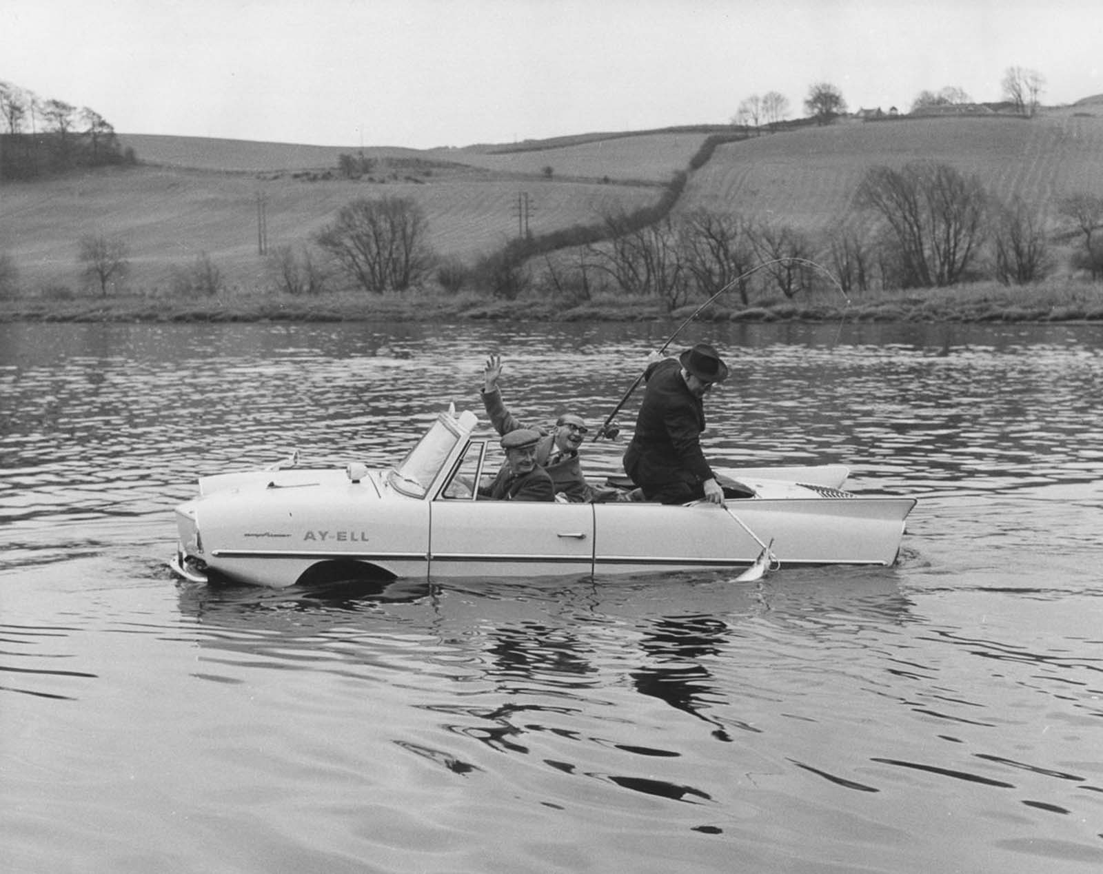 The Amphicar is used as a fishing boat by its owner at the start of the salmon fishing season on the River Tay, Scotland. 1964.