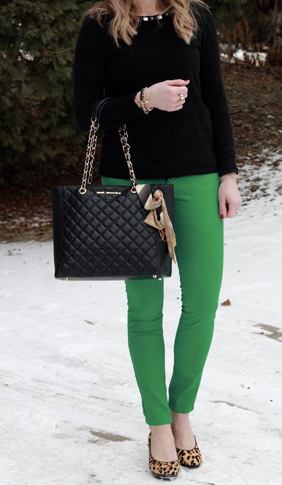 green pants, black sweater, leopard heels