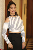 Manjusha in sleevelss crop top and black skirt at Darshakudu pre release ~  Exclusive Celebrities Galleries 034.JPG