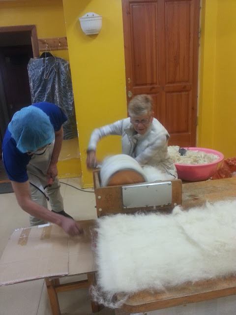 Eileen learning to process wool to turn into felt
