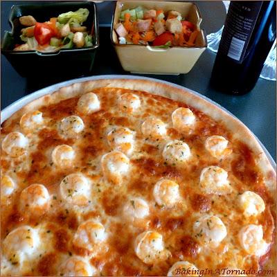 Rosemary Infused Shrimp Scampi Pizza: A crunchy rosemary infused pizza crust topped with homemade marinara, melted cheese and scampi flavored shrimp | Recipe developed by www.BakingInATornado.com| #recipe #pizza #shrimp