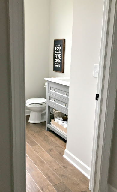 Powder room makeover in navy and white