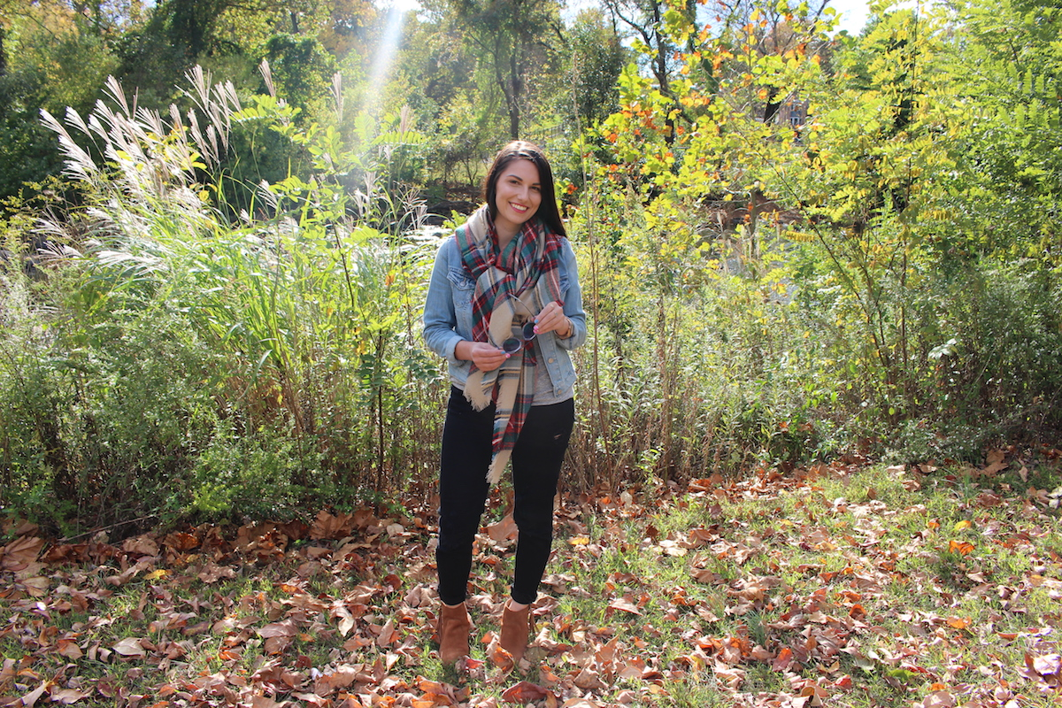 This is a photo of me posing in front of the beautiful fall foliage in Brandywine Park.