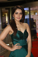 Raashi Khanna in Dark Green Sleeveless Strapless Deep neck Gown at 64th Jio Filmfare Awards South ~  Exclusive 103.JPG