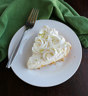 slice of key lime pie on plate with fork