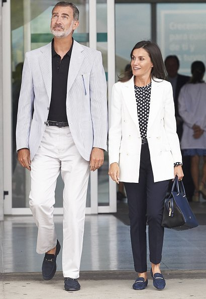 Queen Letizia wore Carolina Herrera navy ecru polka dot silk blouse. Queen Sofía and her sister, Princess Irene of Greece