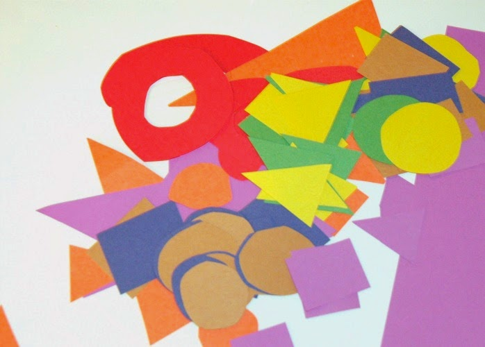 Pile of shapes from colored construction paper