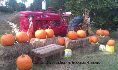 Eclectic Red Barn: Old farm tractor and pumpkin display