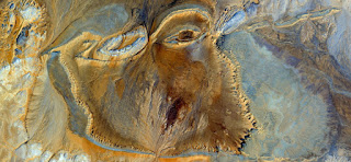 African woman face tortured, raped and stoned,abstract landscapes ,Abstract Naturalism,abstract photography deserts of Africa from the air,abstract expressionism,fantasy forms of stone and colors,