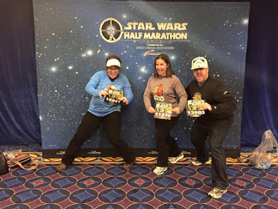 My husband, sister-in-law, and me before the runDisney Star Wars half marathon