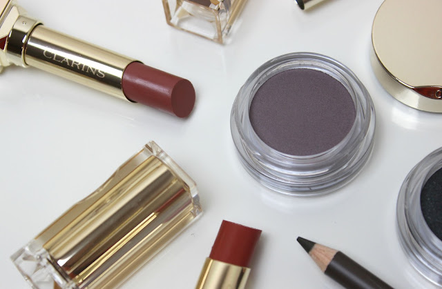 A picture of Clarins Ombre Matte Eyeshadow, Eyebrow Pencil and Rouge Eclat Lipstick