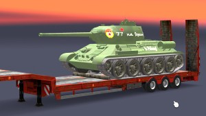 Tank Т-34-85 tank on low bed trailer