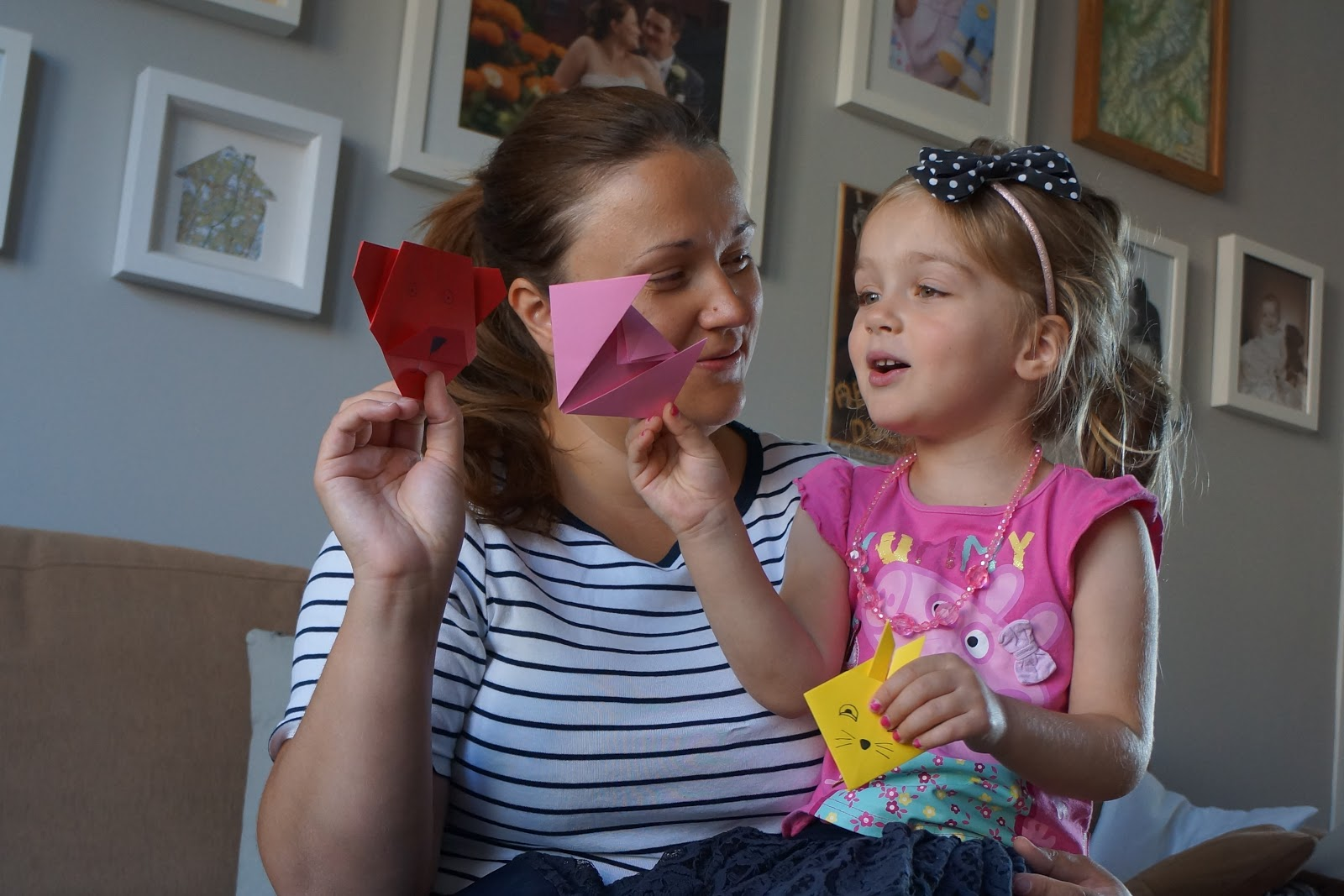 mum and daughter playing with origami