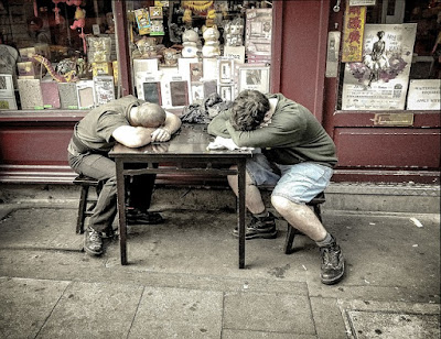 2 Men Laying Their Head Down on the Table