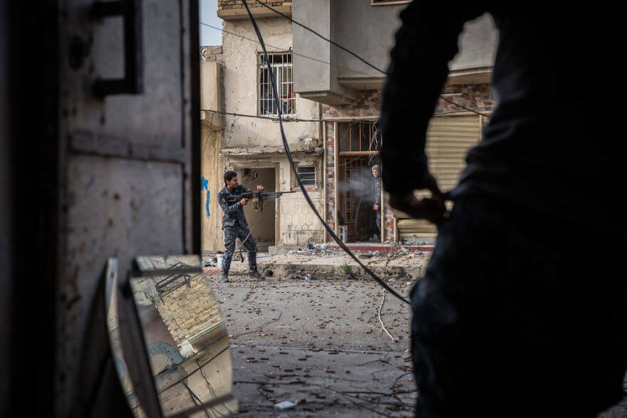 Powerful Heart-Breaking Pictures Of The Battle Of Mosul - Federal Police fire on Islamic State positions in west Mosul