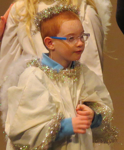 child dressed as an angel