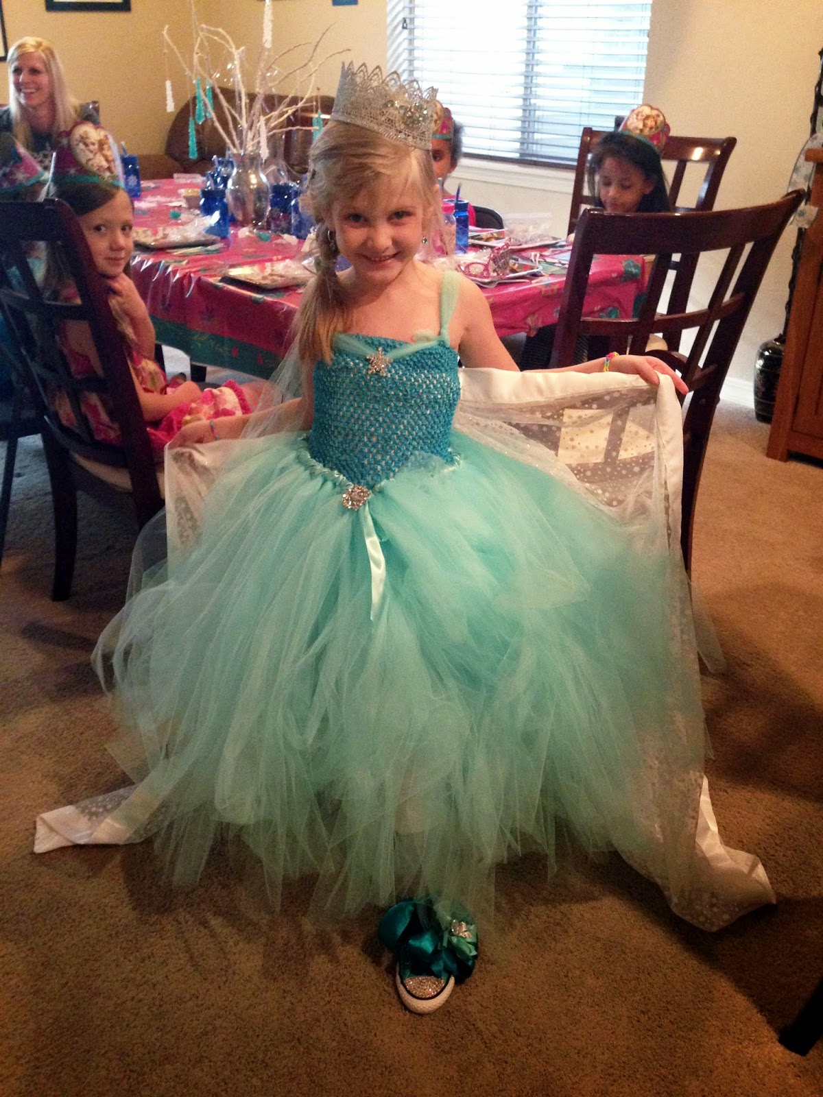 Alice Scraps Wonderland:  DIY Elsa Inspired tutu dress and cape for a Frozen birthday party +  ideas for crown and shoes on blog.