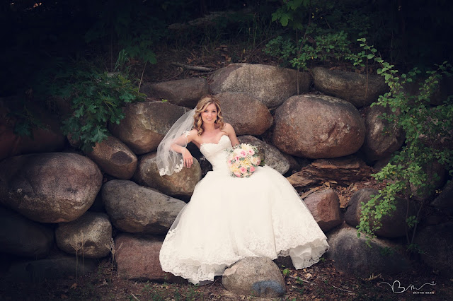 bridal portrait on stone wall at Noah's Event Venue in Auburn Hills Michigan