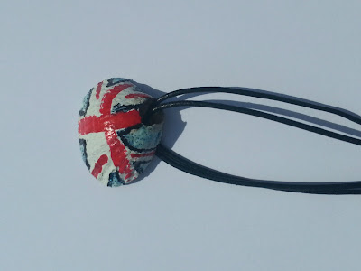 Shell, with union jack painted design, on leather string