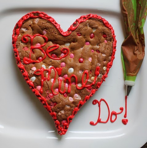 Food Lust People Love: Bake a Big Be Mine Heart Cookie for your sweetheart. A big M&M cookie cake baked in a heart pan and decorated with red sugar icing:  Be Mine!