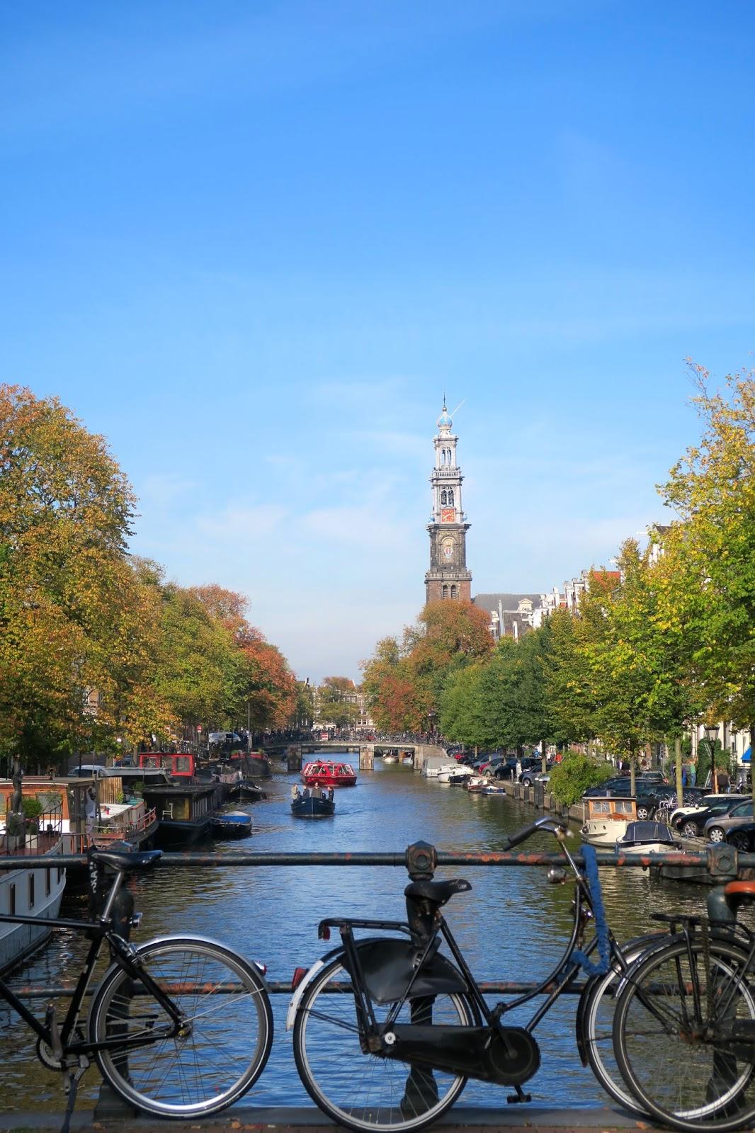Amsterdam Canal Bridge on Sunny autumn day