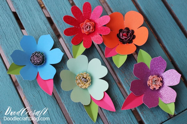 Bright paper flowers cut using the Cricut Maker out of DCWV double sided cardstock stack.
