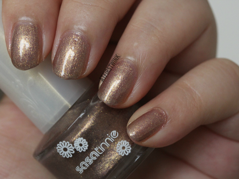 Sasatinnie nail polish P537 - Raspberry gold bronze shimmer foil close up review