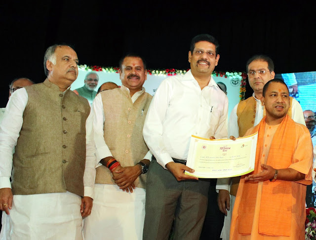 Nipun Sharma - Business Head -UP East Nipun Sharma - Business Head -UP East receving Excellence Award from CM Yogi Adityanath Ji today-