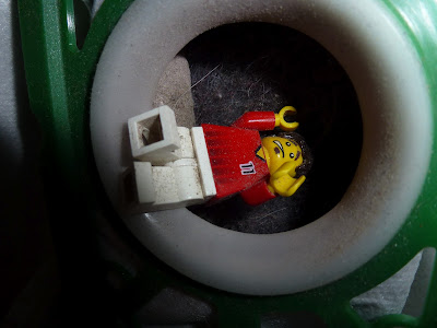 lego minifigure gets sucked up by vacuum