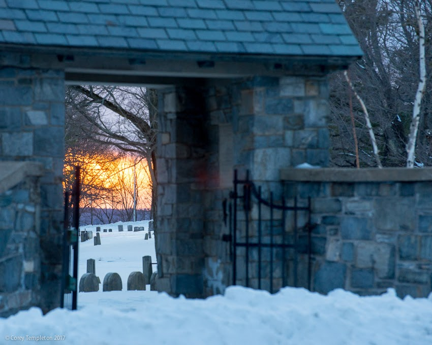 Portland, Maine USA March 2017 photo by Corey Templeton. A sunset viewed between the gates of the Western Cemetery on Vaughan Street.