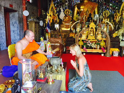 Kate Branch getting blessed by Buddhist Monk
