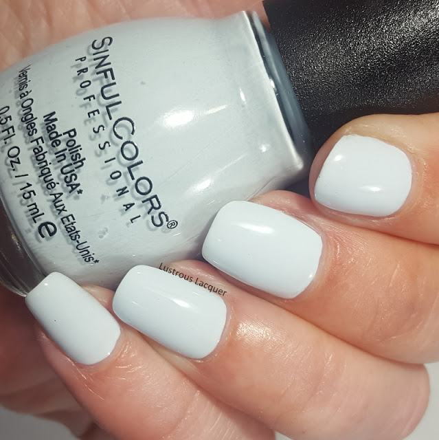 Pale blue nail polish with a creme finish.