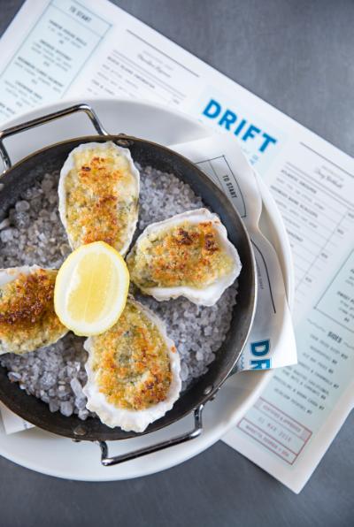Atlanta dish drift fish house oyster bar throws for Drift fish house