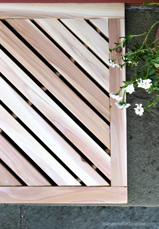 wooden door mat with angled slats