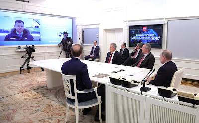 Vladimir Putin watching MIG-35 videoconference.
