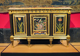 Cabinet by Adam Weisweiler (c1785) incorporating 17th century Florentine decorative panels