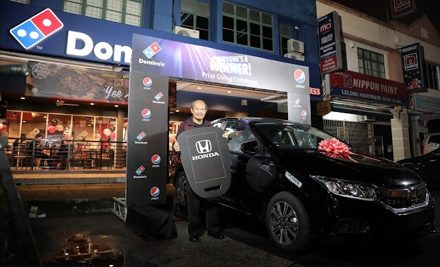 GRAND PRIZE WINNER DRIVES HOME A BRAND NEW HONDA CITY