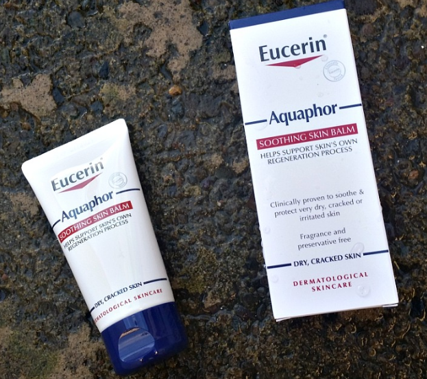 Eucerin Aquaphore skin balm tube and box on a paved floor