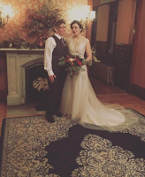 newlywed couple picture at fireplace