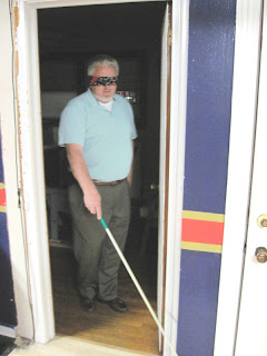 Youth director Bruce tries using the cane