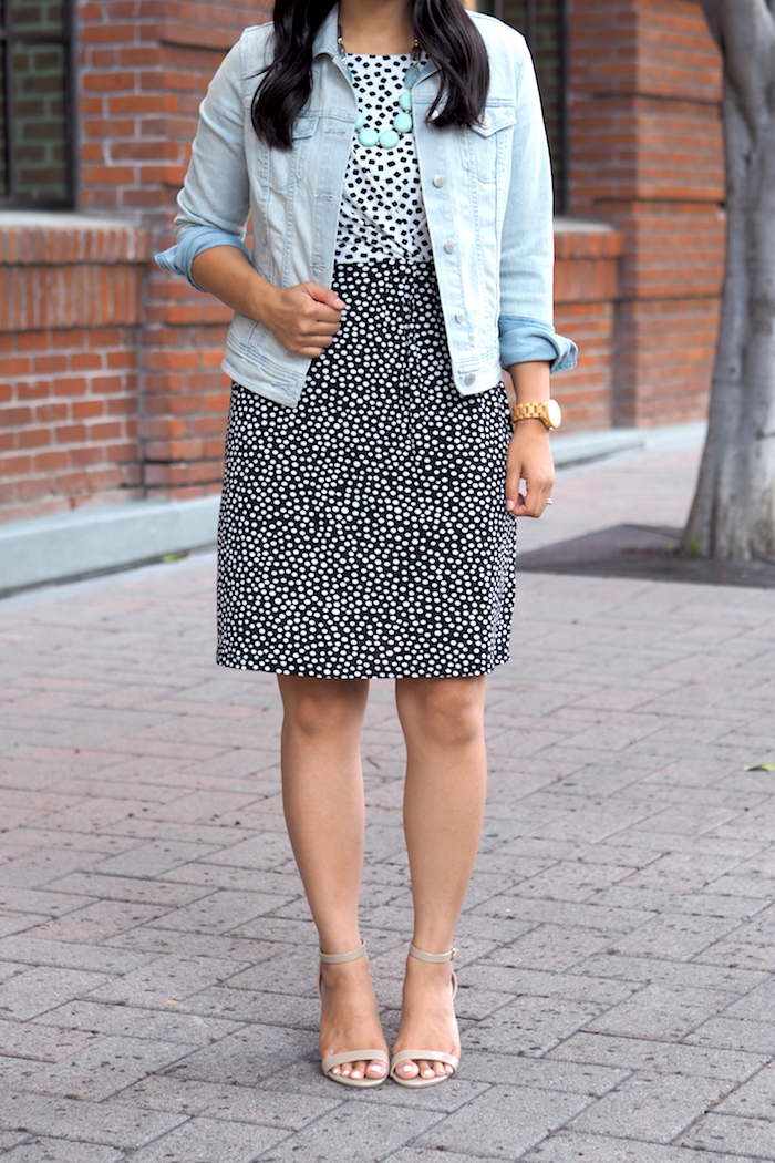 spotted dress + denim jacket + statement necklace + nude heels